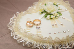 Close-up wedding rings lie on a white pillow Royalty Free Stock Image