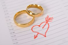 Close-up of wedding rings on paper Stock Photos