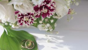 Close up Wedding rings , White roses and lilac flowers . Wedding Fresh bouquet. stock video footage