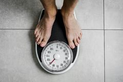 Close-up Weighing Scale ,Men standing on weigh scales. Close-up Weighing Scale ,Men standing on weigh scales stock photos