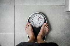 Close-up Weighing Scale ,Men standing on weigh scales. Close-up Weighing Scale ,Men standing on weigh scales royalty free stock photo