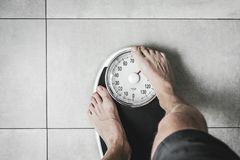 Close-up Weighing Scale ,Men standing on weigh scales. Close-up Weighing Scale ,Men standing on weigh scales stock images