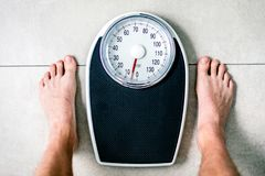 Close-up Weighing Scale ,Men standing on weigh scales. Close-up Weighing Scale ,Men standing on weigh scales stock image