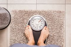 Close-up Weighing Scale ,Men standing on weigh scales. Close-up Weighing Scale ,Men standing on weigh scales stock photography