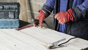 Close-up welder man prepares the welding machine for work. stock video footage