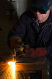 Close up of welder with orange sparks Stock Photo