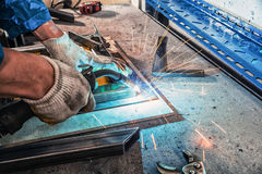 Close up welder weld a metal welding machine Royalty Free Stock Photo