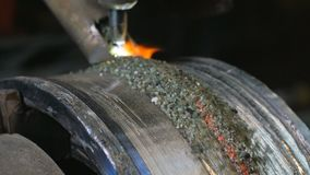 Close up of welding robots apply overlay weld protection on the pipe disks. Automatic welding of pipe-rolling stock video footage