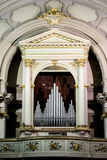 Close up of a well decorated and luxurious pipe organ in a church Stock Photo