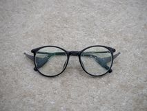 Close up wet black glasses on marble ground royalty free stock photography