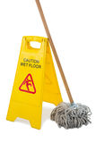 Close up of wet floor sigh board with mop. Against white background Stock Photo