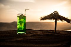 Close up wet glass of green cold mint drink, colorful orange sunset background on the terrace. Cooling summer drink. Summer fresh stock photos