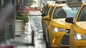 Close up of wet taxis after rain in New York. Video of close up of wet taxis after rain in New York stock video