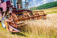Close-up of wheat harvesting machinery. Agricultural activities Stock Image