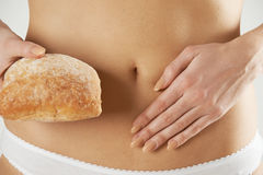 Close Up Of Wheat Intolerant Woman Holding Bread Stock Photography