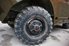 Close up wheel on armored military car. Royalty Free Stock Photography