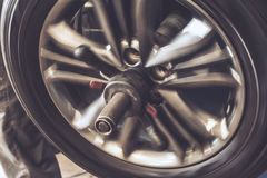 Close up of wheel balancing on special equipment machine tool in auto repair Stock Photo