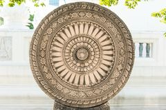 Close up of a wheel of Buddha made from lime stone Stock Photo