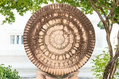 Close up of a wheel of Buddha made from lime stone Royalty Free Stock Photos