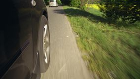 Details automobile drives. Close up wheel car driving on the country road stock video footage