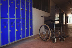 Close up of wheel chair by lockers Royalty Free Stock Photo