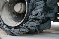 Close-up of a wheel that has burst. Wheel repair. royalty free stock photography