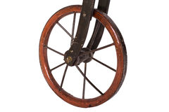 Close up on wheel of a historical bicycle. Close up on wheel of a historical children's bicycle on a white background Stock Images