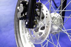 Wheel spokes and brake disc of a motorcycle. Close up - wheel spokes and brake disc of a motorcycle royalty free stock photo