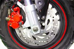 Wheel spokes and brake disc of a motorcycle. Close up - wheel spokes and brake disc of a motorcycle new design technology stock photos