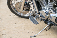 Close up Wheel and Stand motorcycle chopper on the floor. Royalty Free Stock Photo