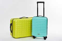Close up of wheeled suitcases. Bright summer luggage, white background. Cases for journey Stock Photography
