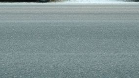 Close-up wheels of cars traveling on the road in winter in both directions. Road without snow.  stock footage