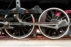 Close up wheels on steam powered locomotive. Royalty Free Stock Images