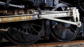 Close up wheels on stream powered locomotive. Royalty Free Stock Images