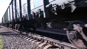 Close up of wheels of train going by railway stock video footage