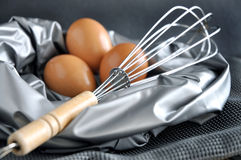 Close up whisk with eggs on background Royalty Free Stock Image