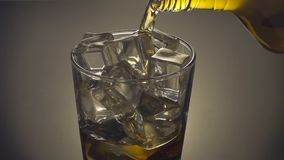 Close up Whiskey being poured into a glass stock footage