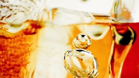 Close-up of whiskey in glass with ice used for background stock footage