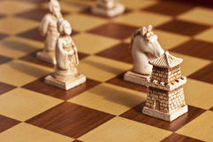 Close up of white antique chess pieces Royalty Free Stock Photography