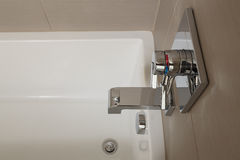 Close up of white bathtub with chrome fixtures Royalty Free Stock Photo