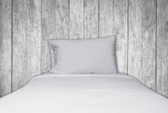 Close up white bedding and pillow on wooden background Royalty Free Stock Photos