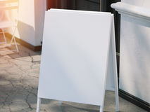 Close up of white blank menu board on sidewalk. 3d rendering stock photography