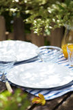 Close up white ceramic dish and wooden table Stock Photos