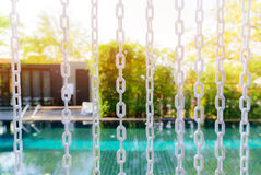Close-up The white chain curtain and blur swimming pool Royalty Free Stock Images