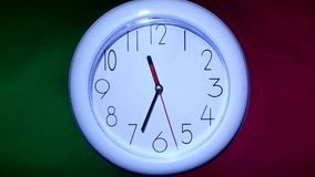 Close up of an white clock on colorful background. Close up of an white office clock on colorful background with clipping path stock video
