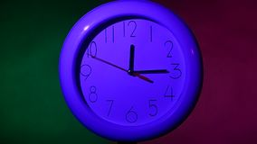 Close up of an white clock on colorful background. Close up of an white office clock on colorful background with clipping path. slow motion stock footage