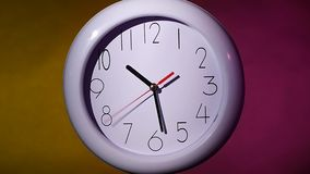 Close up of an white clock on colorful background. Close up of an white office clock on colorful background with clipping path. At 10:30 times. slow motion stock video