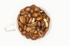 Close Up Of A White Coffee Cup Full Of Coffee Beans Stock Photos
