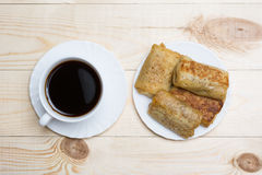 Close up white coffee cup and pancakes with cottage cheese on wo Royalty Free Stock Image