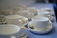 Close-up white coffee cup on table Royalty Free Stock Images